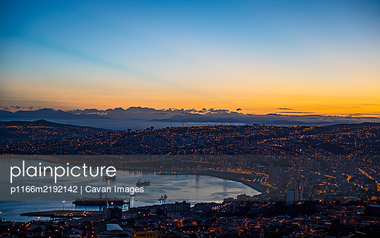 sunset over the bay and town of Valparaiso in Chile - p1166m2192142 by Cavan Images
