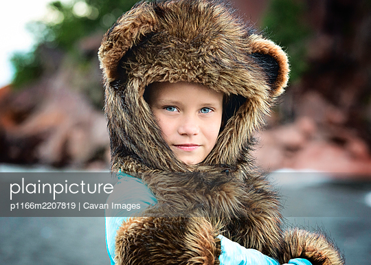 Young Girl in Spirit Hood Outdoors - p1166m2207819 by Cavan Images