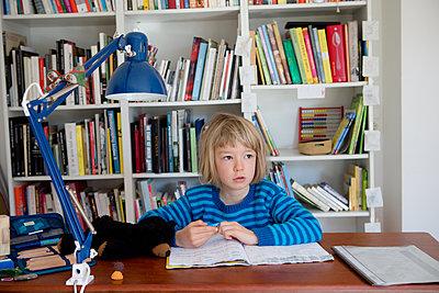 Girl doing homework - p505m2169010 by Iris Wolf