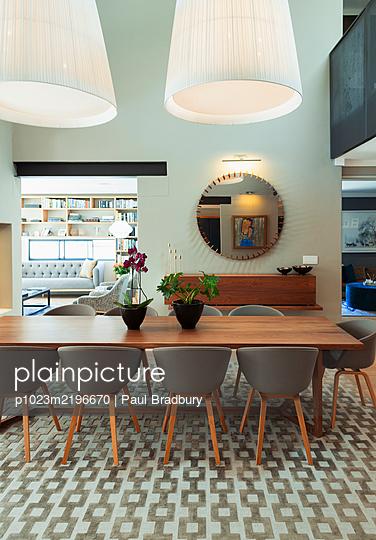 Modern home showcase interior dining room - p1023m2196670 by Paul Bradbury