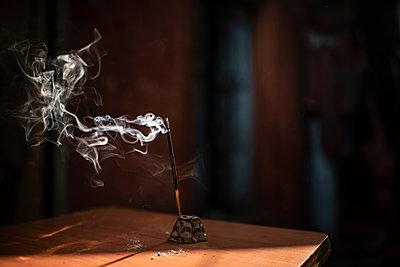 Incense stick burning - p1007m2099037 by Tilby Vattard