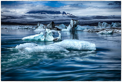 Drift ice near Icelandic coast - p1154m1110137 by Tom Hogan