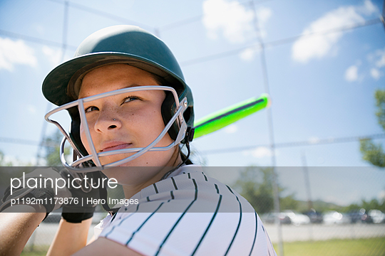 Middle school girl softball player ready to bat