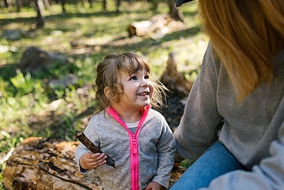 Little daughter (2-3) with her mother camping in Uinta-Wasatch-Cache National Forest - p1427m2213537 by Jessica Peterson