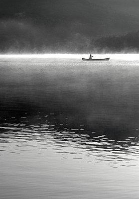 Woman canoeing on Lake Placid Lake - p1427m2254879 by Chris Hackett