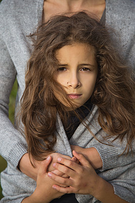 Close-up girl in the arms of her mother. - p1166m2236729 by Cavan Images