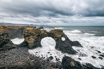 High angle view of rock formations in sea against cloudscape - p1166m1403759 by Cavan Images