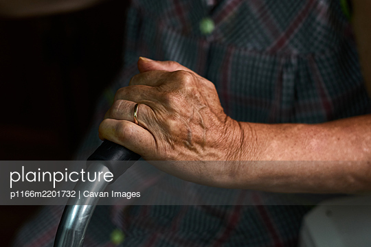 Close-up of an old lady holding her walker - p1166m2201732 by Cavan Images