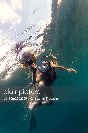 Female diver with camera,Perebutan, Bali, Indonesia - p1166m2202335 by Konstantin Trubavin