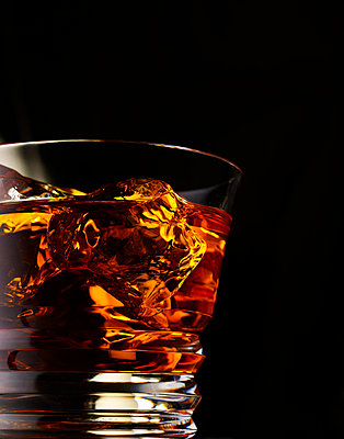 Glass filled with whiskey - p5490330 by C&P