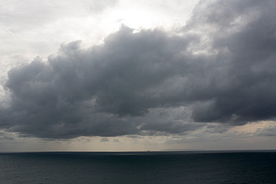 Rain clouds over the sea  - p1057m2008604 by Stephen Shepherd