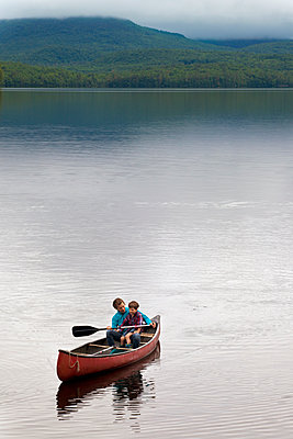 Mother and young son canoeing on Kezar Lake - p343m1167894 by Monica Donovan