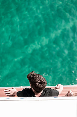Teenager on boat - p947m2119503 by Cristopher Civitillo