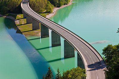 High angle view of tall road bridge crossing dam - p1100m1520193 by Mint Images
