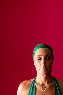 Woman in meditation position during a yoga session - p590m2020680 by Philippe Dureuil