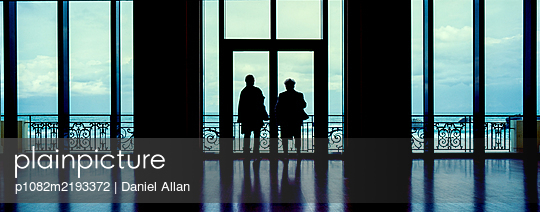 Two Ladies looking out  - p1082m2193372 by Daniel Allan