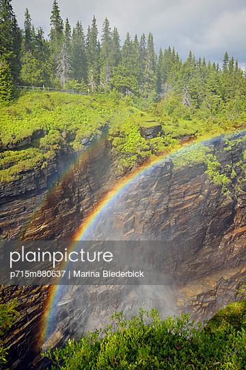 Rainbow above a water fall - p715m880637 by Marina Biederbick