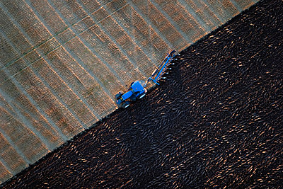 Agricultural machine in arable land - p5754053 by Roine Magnusson