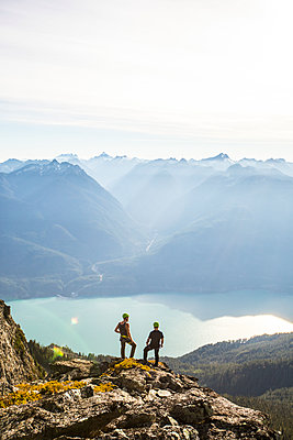 Silhouette of two climbers on Douglas Peak, British Columbia. - p1166m2095187 by Cavan Images