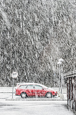 Car on road at winter - p312m1024905f by Mikael Svensson