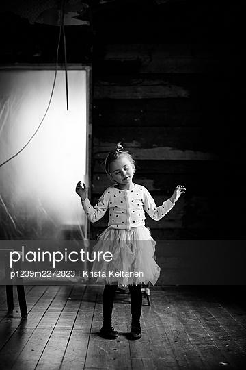 Little girl in a ballet skirt - p1239m2272823 by Krista Keltanen