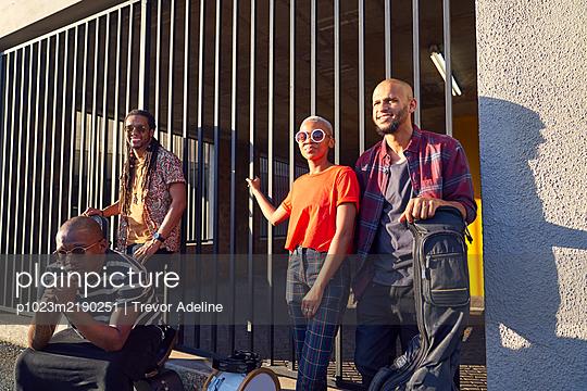 Portrait confident musicians outside sunny parking garage - p1023m2190251 by Trevor Adeline