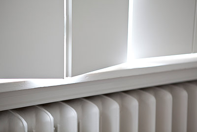 Radiator under windows - p1371m1225748 by Virginie Perocheau