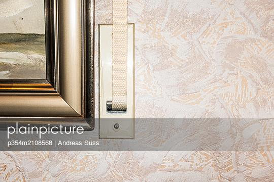 Belt winder roller shutter beside painting - p354m2108568 by Andreas Süss