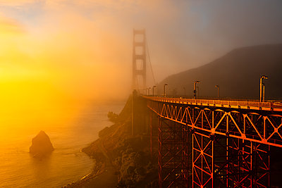 Golden Gate Bridge bathed in Fog filtered Sunlight - p1166m2130376 by Cavan Images