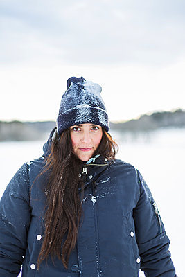 Portrait of young woman in snow - p352m1536597 by Calle Artmark
