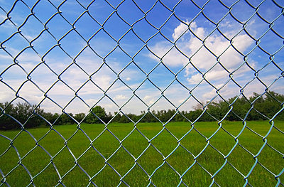 Looking At The Sky Through A Chain Link Fence - p44211543f by Darren Greenwood
