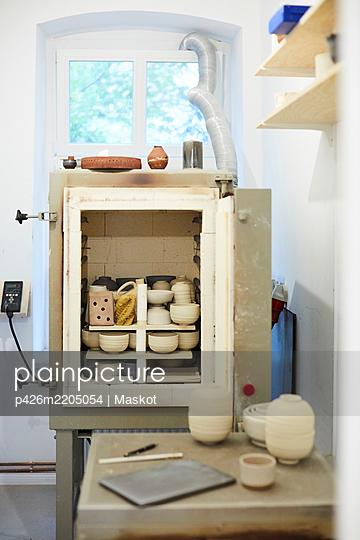 Various earthenware on shelves in art studio - p426m2205054 by Maskot
