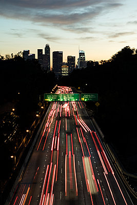 Road traffic to Los Angeles in the evening - p1094m2057239 by Patrick Strattner
