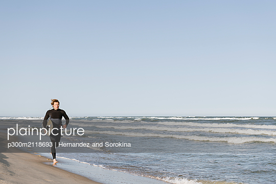 Surfer running at the beach - p300m2118693 by Hernandez and Sorokina