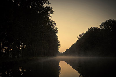 Canal in the morning with fog - p1312m2258016 by Axel Killian