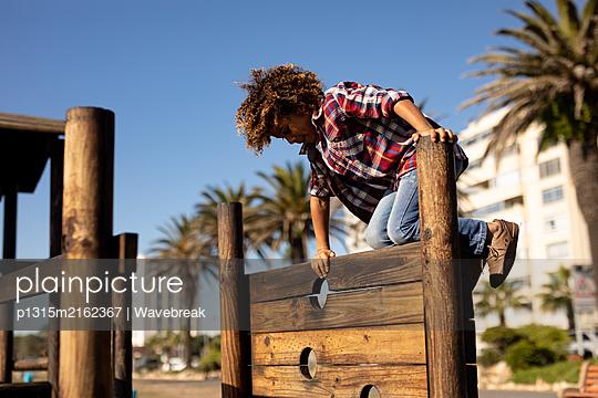 Boy enjoying a day out on playground - p1315m2162367 by Wavebreak