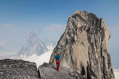 Mountain climber at west ridge of Pigeon Spire, Bugaboo Mountains, British Columbia, Canada - p343m1520864 by Suzanne Stroeer