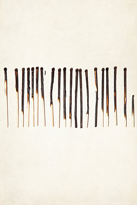 Row of Burnt Matches - p1248m1550489 by miguel sobreira