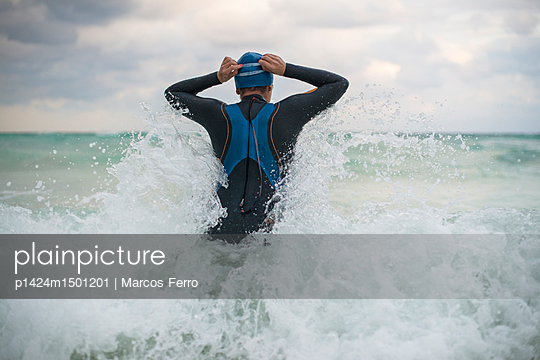 A swimmer getting into the ocean in Tulum, Mexico. - p1424m1501201 by Marcos Ferro photography
