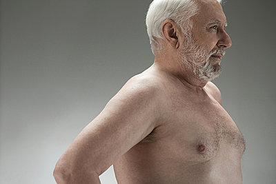 Bare chested senior man - p9244552f by Image Source