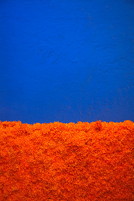 Blue Wall with Paper Marigolds for Day of the Dead  - p1248m2210895 by miguel sobreira