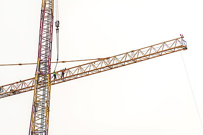 Two construction workers on a crane - p1292m2272653 by Niels Schubert