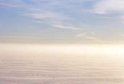 Mist on icy sea - p3222146 by Kimmo von Lüders