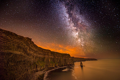 The Milky way visible over the Cliffs of Moher, Doolin, Clare, Ireland - p429m2019863 by George Karbus Photography