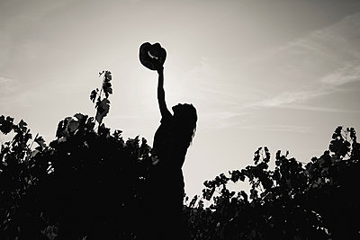 Shadow of a woman in vineyard - p1150m2127048 by Elise Ortiou Campion