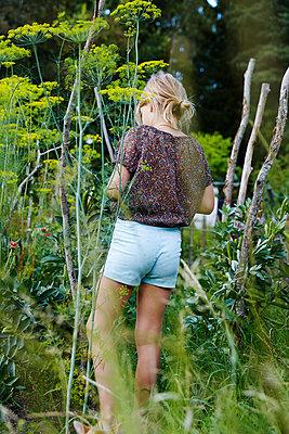 Girl in garden - p312m2091882 by Anna Kern