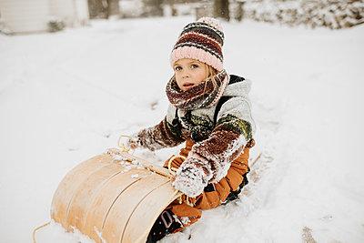 Canada, Ontario, Girl (2-3) on toboggan - p924m2271230 by Sara Monika