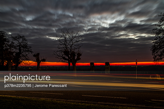 Road at sunset - p378m2235795 by Jerome Paressant