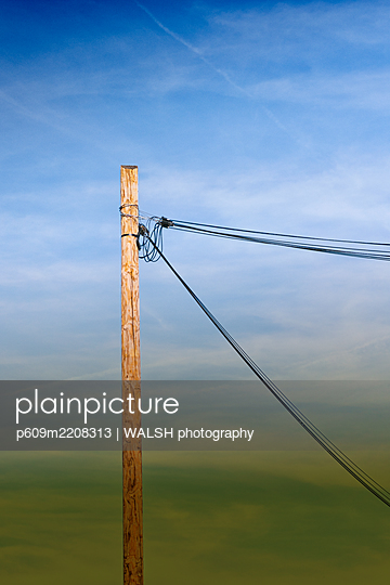 Wooden telephone power pole cables sly  - p609m2208313 by WALSH photography
