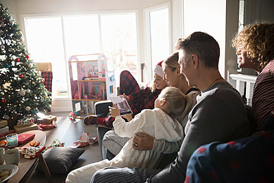 Family taking selfie with digital tablet in Christmas living room - p1192m1512248 by Hero Images